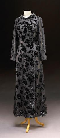 Evening gown, grey silk with black silk and velvet overlay.